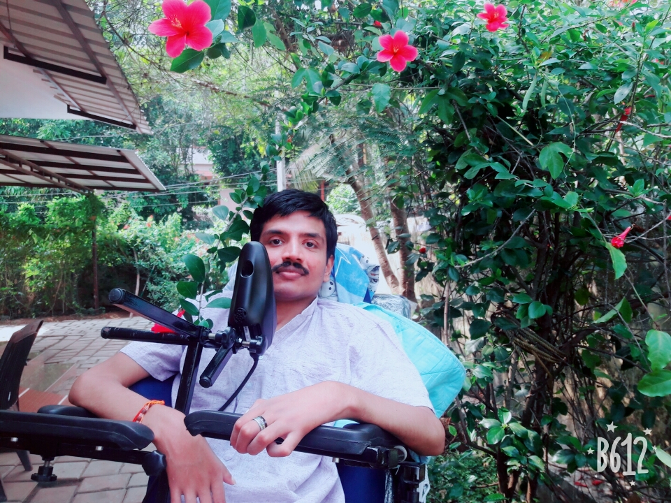Quadriplegic Ajay in wheelchair